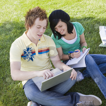 Teen couple do homework stock photo, Teen couple do homework in the grass by Rick Becker-Leckrone