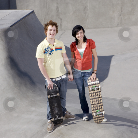 Couple at skateboard park stock photo, Teen couple at skateboard park by Rick Becker-Leckrone