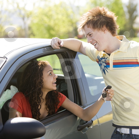Happy teen shows off car  stock photo, Happy teen shows off car by Rick Becker-Leckrone