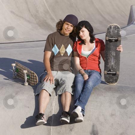 Kids at skatepark stock photo, Teen skater couple at skatepark by Rick Becker-Leckrone
