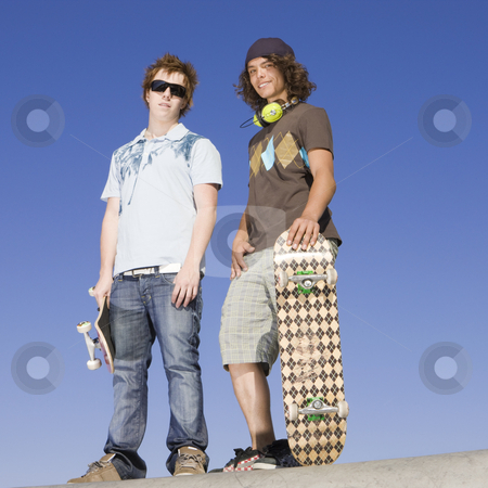 Teen skaters atop ramp stock photo, Two teen skaters atop ramp by Rick Becker-Leckrone