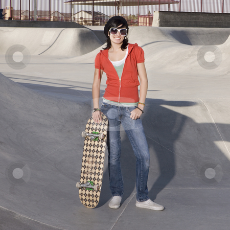 Skater girl at a park stock photo, Girl with skateboard at the park by Rick Becker-Leckrone