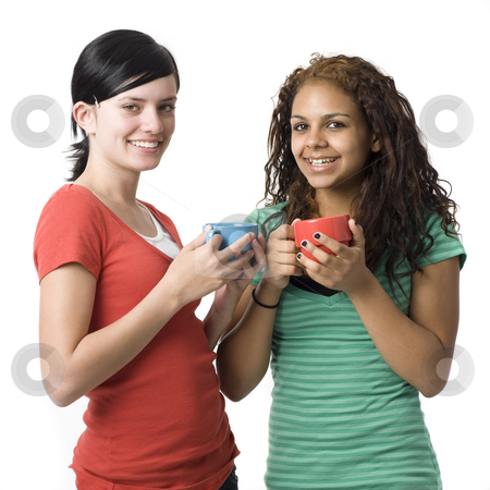 Two girls with coffee cups stock photo, Two girs with coffee cups smile by Rick Becker-Leckrone