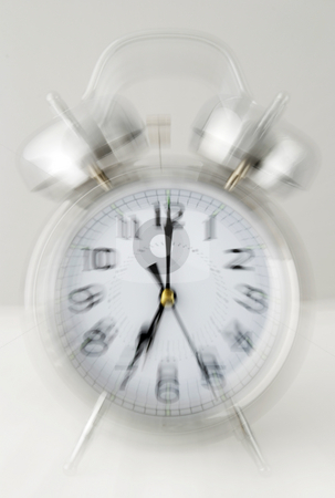 Ringing alarm clock stock photo, Loud ringing chrome alarm clock by Paul Turner