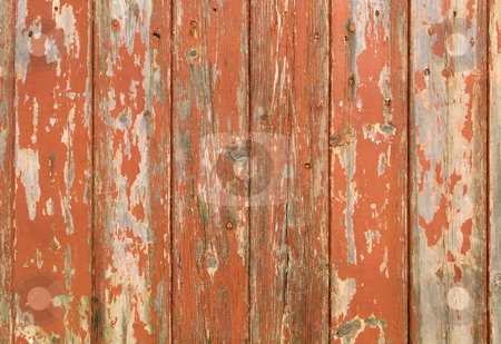 Orange flaky paint on a wooden fence. stock photo, Orange flaky paint on a wooden fence. by Stephen Rees