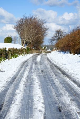 An English country road covered in snow and ice. stock photo, An English country road covered in snow and ice. by Stephen Rees