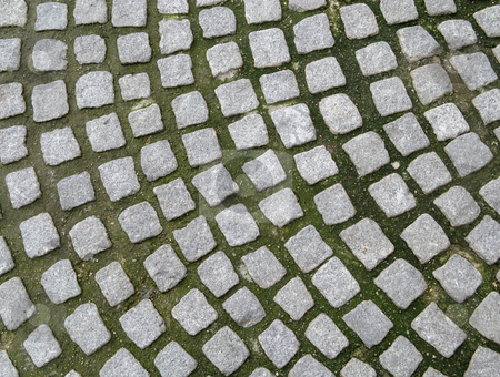 Close up of old cobblestones paving. stock photo, Close up of old cobblestones paving. by Stephen Rees