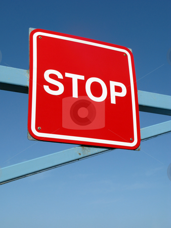 Close up of a red stop sign on a barrier. stock photo, Close up of a red stop sign on a barrier. by Stephen Rees