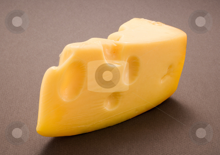 Swiss Cheese stock photo, Swiss Cheese isolated on a dark background by Danny Smythe