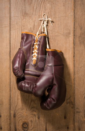 Boxing Gloves stock photo, Boxing Gloves hanging against an old wood wall by Danny Smythe