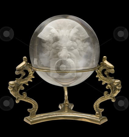 Crystal Ball with a Wizard Face stock photo, Crystal Ball isolated on a black background by Danny Smythe