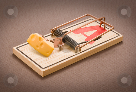 Mousetrap with Bait stock photo, Mousetrap with Bait isolated on a dark background by Danny Smythe