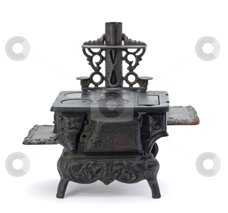 Old Miniature Stove stock photo, Old Miniature Stove isolated on a white background by Danny Smythe