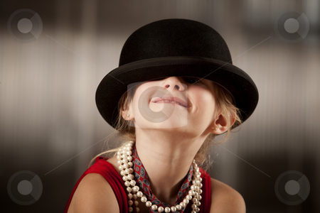 Girl with her face in her hat stock photo, Funny young girl with her face hidden in her hat by Scott Griessel