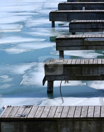 Docks on lake-Colour stock photo, Colour photograph of wooden docks extending into a frozen lake by Wes Shepherd