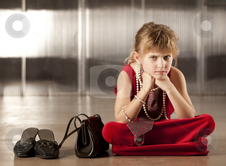 Sullen young girl in red stock photo, Sullen young girl with big eyes in dress-up clothes by Scott Griessel