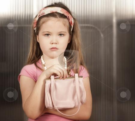 Little girl with pink purse stock photo, Young girl with headband and a grownup's pink purse by Scott Griessel