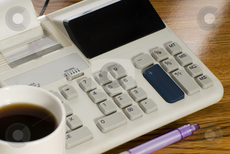 Adding Machine stock photo, Closeup view of an adding machine and a cup of coffee by Richard Nelson