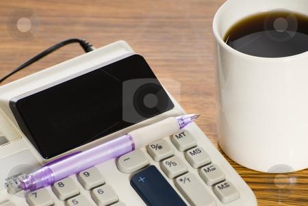 Closeup Calculator stock photo, Closeup view of a calculator, shot on a wooden desk by Richard Nelson