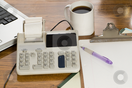 Office Desk stock photo, A top view of an office desk with focus on the calculator by Richard Nelson