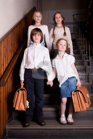 Kids in format stock photo, Group of little students with different ageson the stairs by Frenk and Danielle Kaufmann