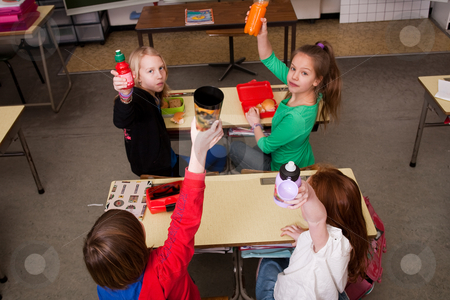 Drinking children stock photo, Group of little students with different ages in a classroom by Frenk and Danielle Kaufmann