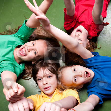 Schoolkids are yelling stock photo, Group of little students with different ages in a happy mood by Frenk and Danielle Kaufmann