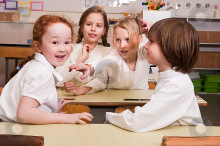 Having fun in the class stock photo, Group of little students with different ages in a classroom by Frenk and Danielle Kaufmann