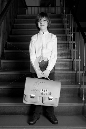 Standing with my bag stock photo, Young boy on a school in a old schooloutfit by Frenk and Danielle Kaufmann