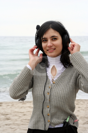 Listening to music stock photo, The girl has closed eyes and hears the sea by Aleksandr GAvrilov