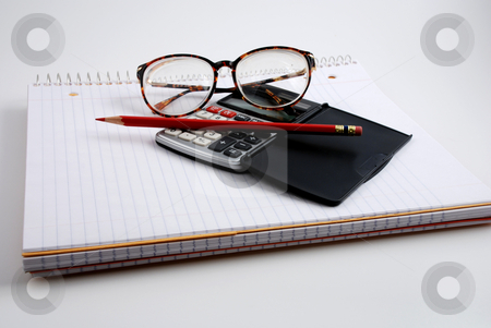 Calculating stock photo, Pictures of a calculator and glasses resting on a notepad, ready to do calculations by Albert Lozano