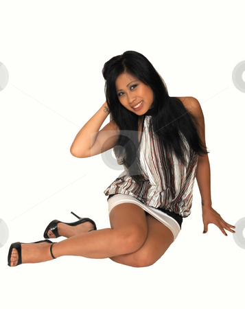Young Asian girl sitting. stock photo, An young Asian girl in a nice top and white short skirt, long black hair  sitting on the floor in an studio for white background. by Horst Petzold