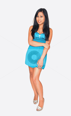 Young Asian girl standing. stock photo, An young Asian girl in a nice blue dress, long black hair  standing in an studio for white background. by Horst Petzold