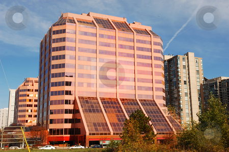 Modern pink high-rise. stock photo, A very nice looking pink glass and concrete office building in downtown of Mississauga. by Horst Petzold