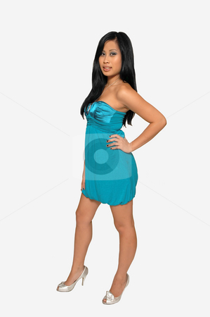 Lovely Asian girl. stock photo, Pretty black haired Asian girl in a short blue dress standing in an studio for white background. by Horst Petzold