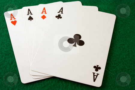 Four Aces stock photo, Card hand of four aces on a green felt surface by Terry McClary