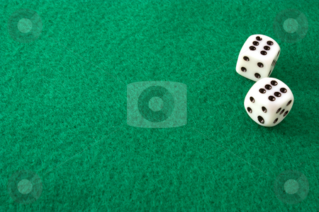 Double Sixes stock photo, Dice rolled to double sizes on a green felt table by Terry McClary