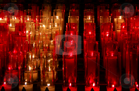 Candles stock photo, Rows of lighting candles in glasses by Pavel Cheiko