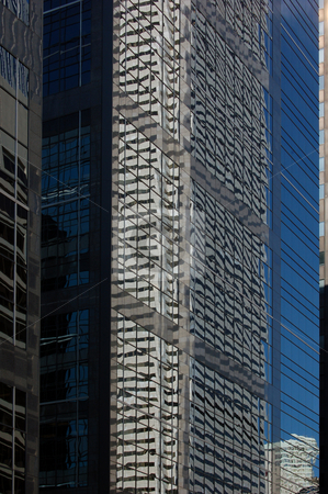 Building stock photo, Reflection in a glass wall of a high-rise building by Pavel Cheiko