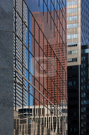 Building stock photo, Reflected in a glass wall of a high-rise building by Pavel Cheiko