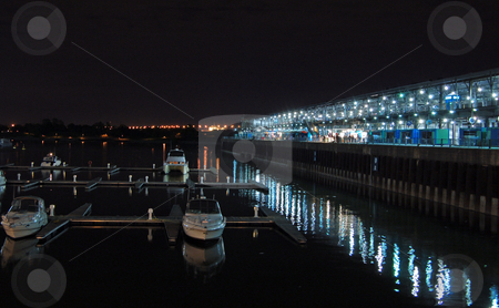 Pier stock photo, Night view of St. Lawrence river in Montreal downtown by Pavel Cheiko
