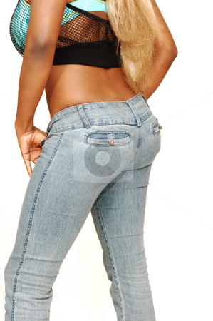 Young Jamaican girl. stock photo, An busty young Jamaican girl in jeans whit long blond hair and high heels standing in a studio for white background. by Horst Petzold
