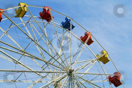 Carnival Ferris Wheel stock photo, Ferris Wheel great abstract of colorful ferris wheel and blue sky by Maria OBrien
