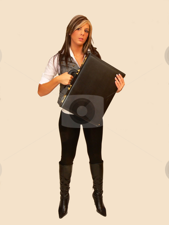 Young lady in jeans. stock photo, An young lady in black tights and a white vest standing for beige background and holding an briefcase. by Horst Petzold