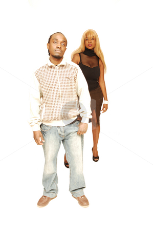 Young black couple. stock photo, African American couple standing in an studio for white background. by Horst Petzold