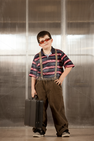Little boy in adult clothes stock photo, Handsome young boy in adult business clothes by Scott Griessel