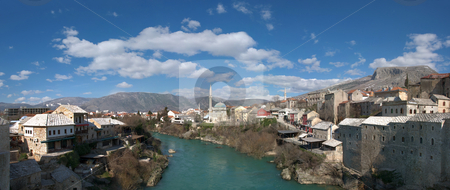 Panorama of Neretva River in Mostar Old Town stock photo, Panorama of Neretva river in Mostar Old Town on a sunny winter day. by Denis Radovanovic