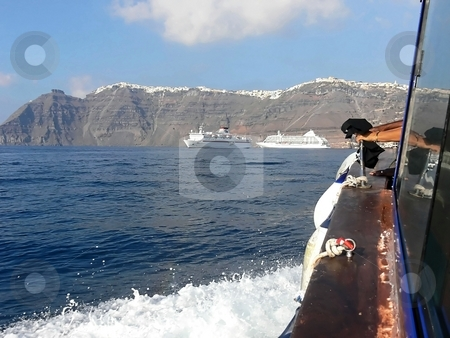 In front of santorini.  stock photo, With an tuck beat from the cruise ship to the island of Greek Santorini. by Horst Petzold