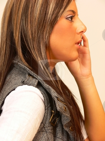 Young lady on the phone. stock photo, An young lady for beige background talking on the cell phone. by Horst Petzold