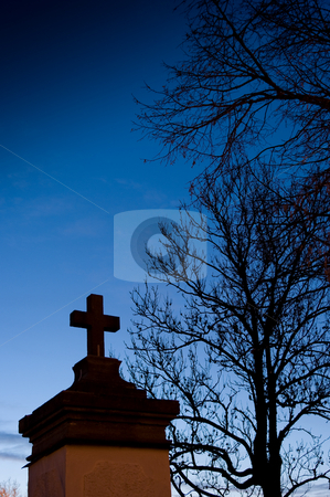 The Cross stock photo, An old stone cross at an entrance to an old church. A cold winter night. by Peter Soderstrom